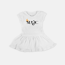 white baby dress printed with the word magic and a yellow moon