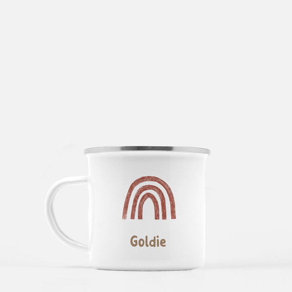 white mug printed with a brown rainbow and the name Goldie