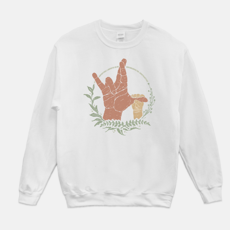 White, adult unisex sweatshirt printed with an adult hand forming the American Sign Language (ASL) sign for I really love you. The adults thumb is being grasped by a childs hand.