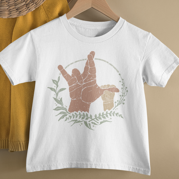 American sign language toddler tee shirt printed with the sign for I really love you being formed by an adult hand with a baby hand holding the thumb