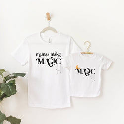 mommy and me white tee shirts, the large size is printed with the words mamas make magic, and the childs size is printed with the word magic, and a yellow moon