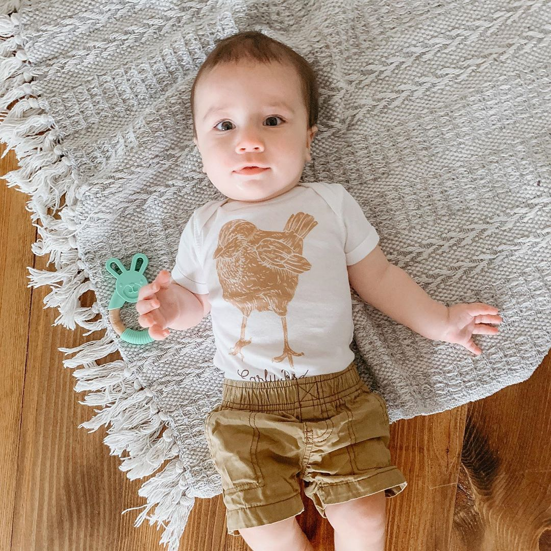 toddler wearing a shirt with a large brown bird on it