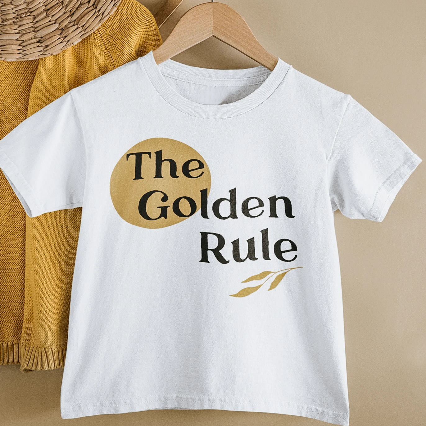A white tee shirt that says the golden rule on it