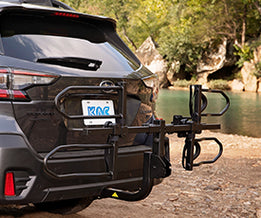 KAC K2 Overdrive Sport Hitch Mounted Bike Rack on the back of a grey Subaru Outback