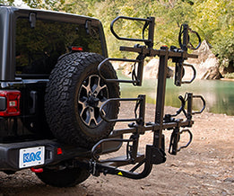 KAC K4 Overdrive Sport Hitch Mounted Bike Rack on the back of a Jeep with spare tire