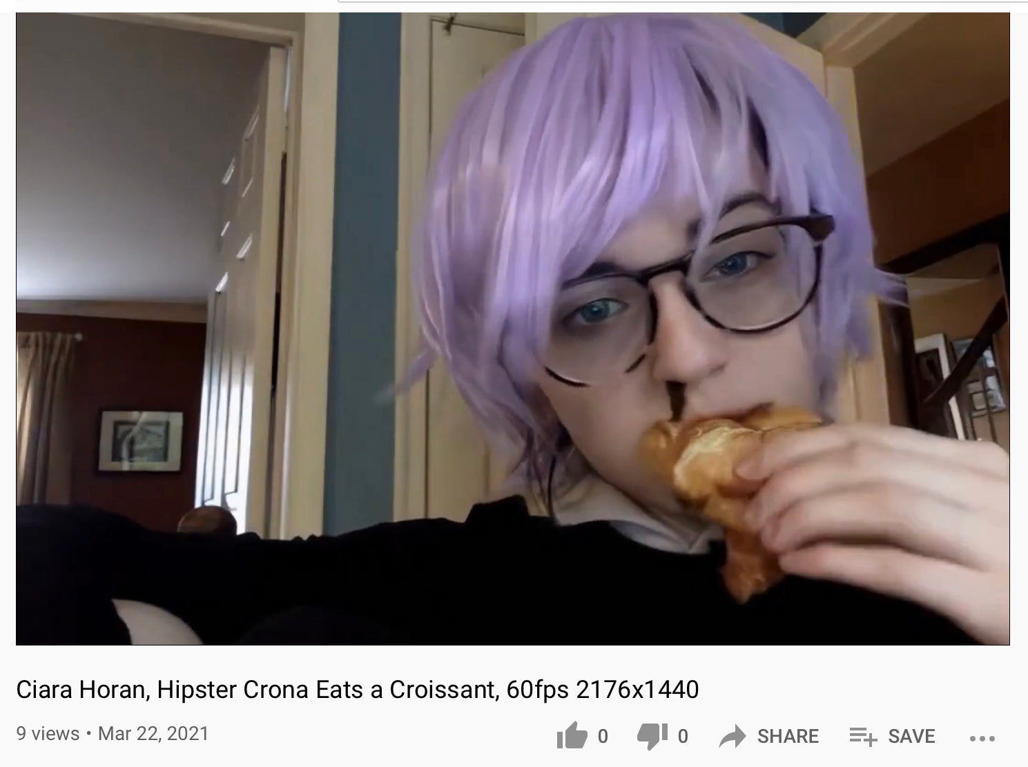 Archival material of Ciara Horan as a fancy hipster croissant-eating E-girl replete with wig and nosebleed (Photo: @angelicism01 on YouTube)