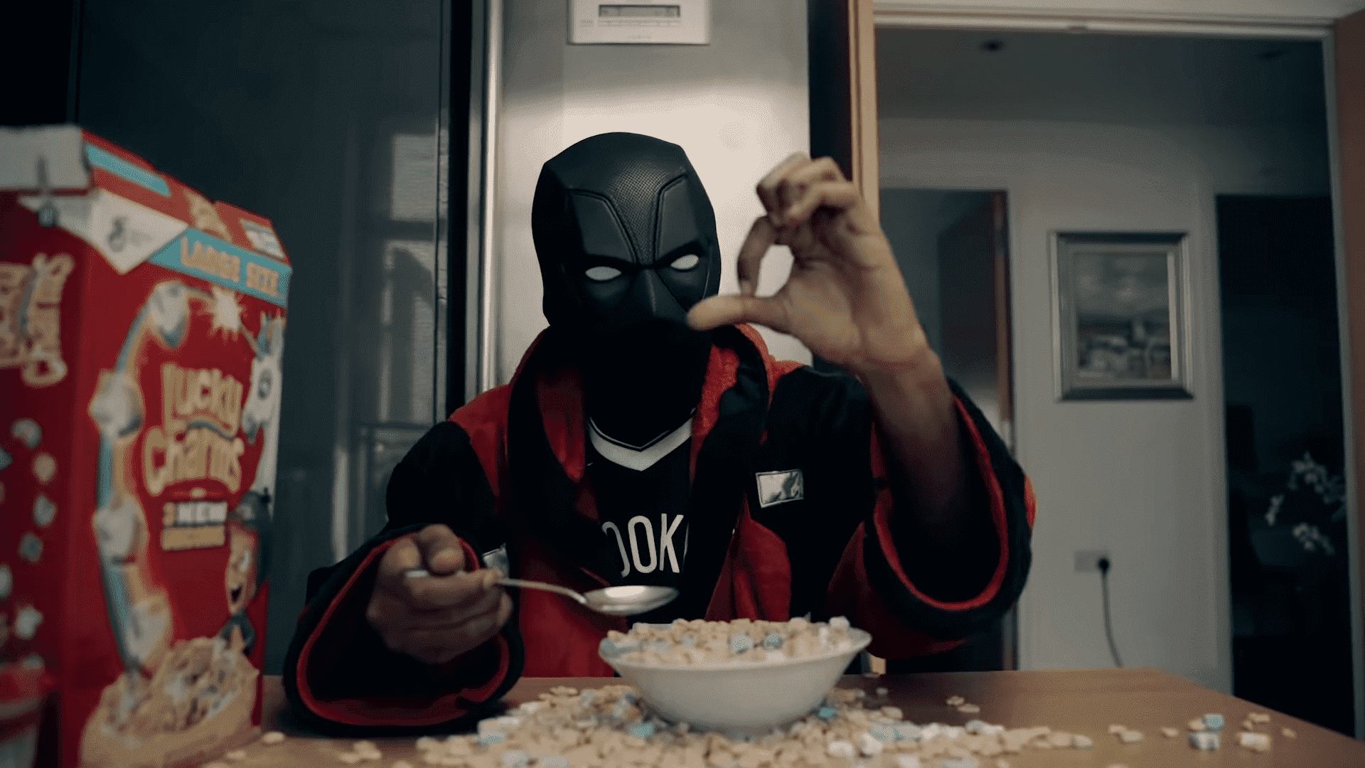 """V9 in his music video for the song """"Right or Wrong"""", where he dons his trademark face covering like many other drill rappers who wish to conceal their identity."""