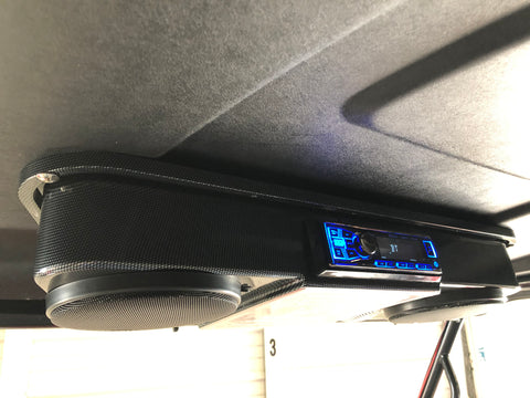 Overhead radio and speakers