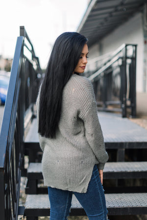 ALL ABOUT HER DISTRESSED SWEATER