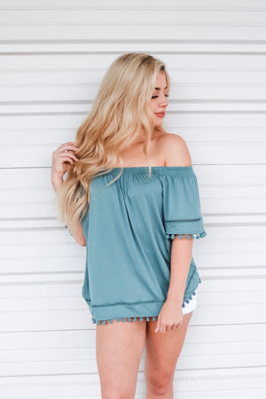 READY TO FIESTA POM POM TOP DUSTY GREEN