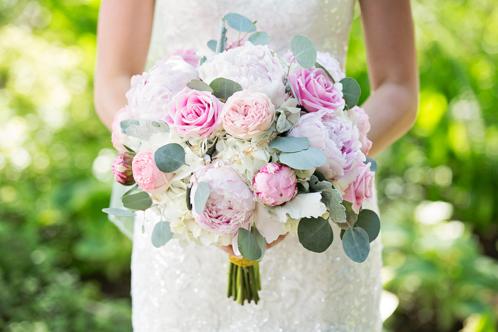 Beautiful pastel coloured flowers in a bridal bouquet.