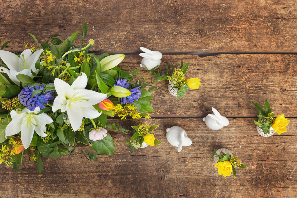 Sherwood Park Easter flowers with white bunnies on barnwood background
