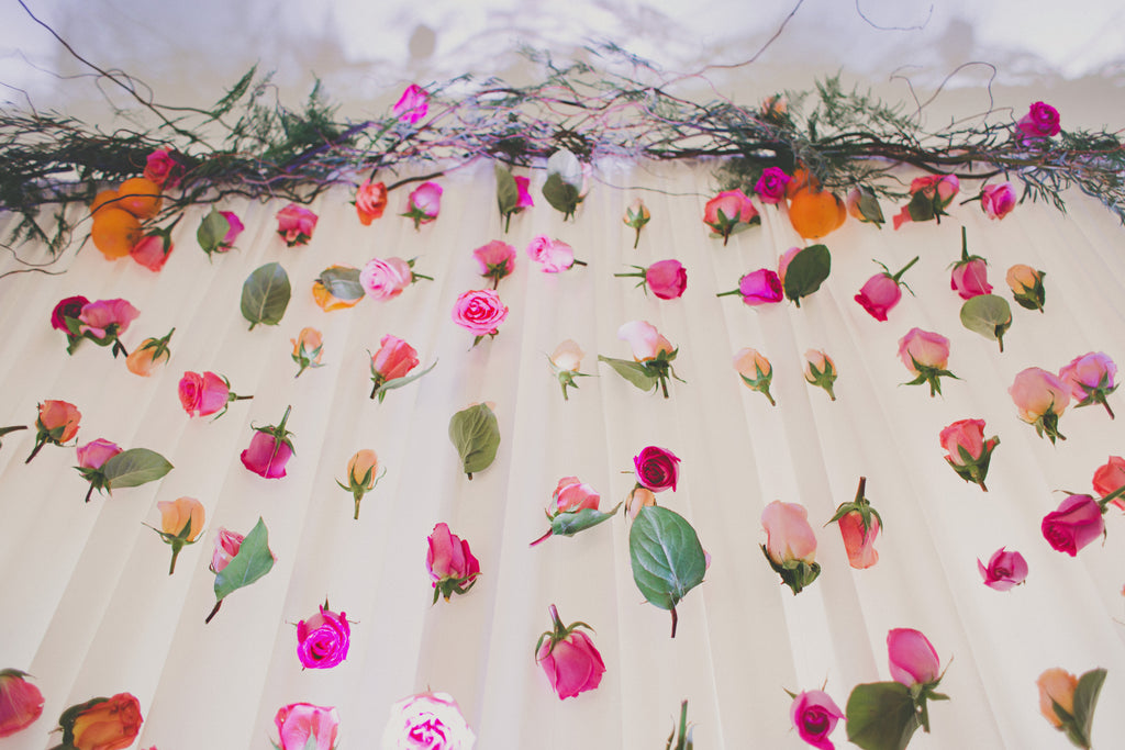 Roses, petal and leaves floating down on sheer draper for a wedding design by Tickled Floral owner, Wendy Larson.