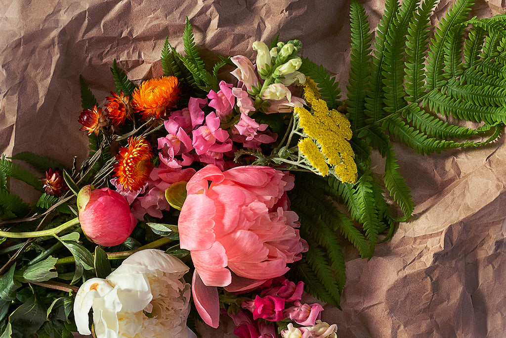 A bundle of farm fresh flowers on kraft paper