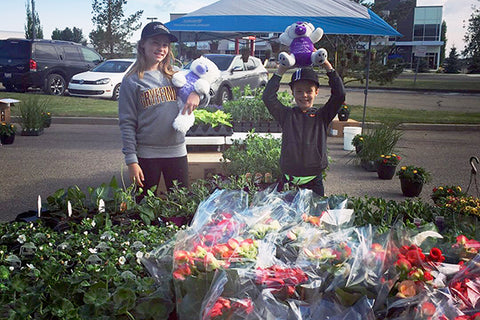kids selling plants for the stollery hospital