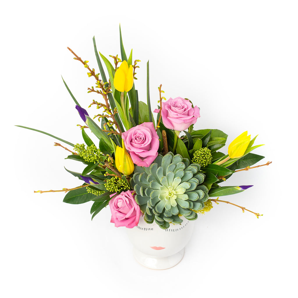 Floral arrangement in a face pot, designed by Tickled Floral in Sherwood Park, delivery to Edmonton, Beaumont, St.Albert