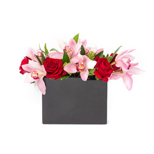 Roses and Orchids floral arrangement in a black sleek pot, designed by Tickled Floral in Sherwood Park, delivery to Edmonton, Beaumont, St.Albert