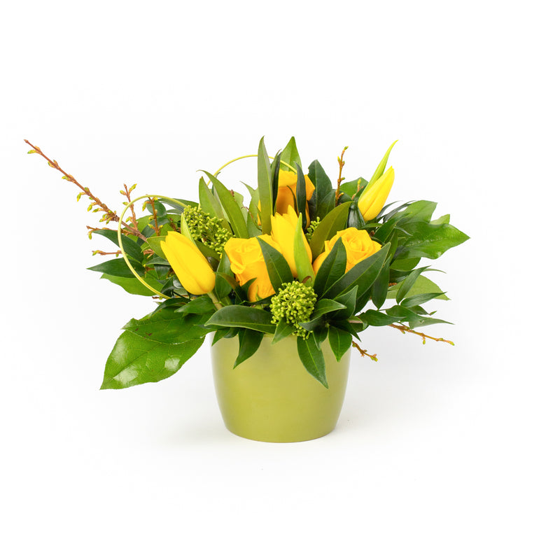A floral arrangement of yellow tulips and roses. Floral design by Tickled Floral in Sherwood Park, AB