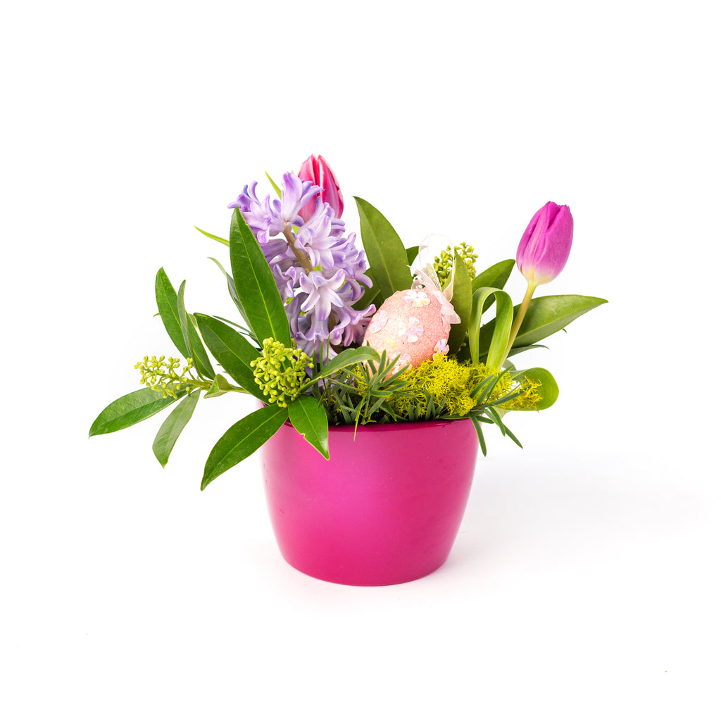 easter floral arrangement in a hot pink pot