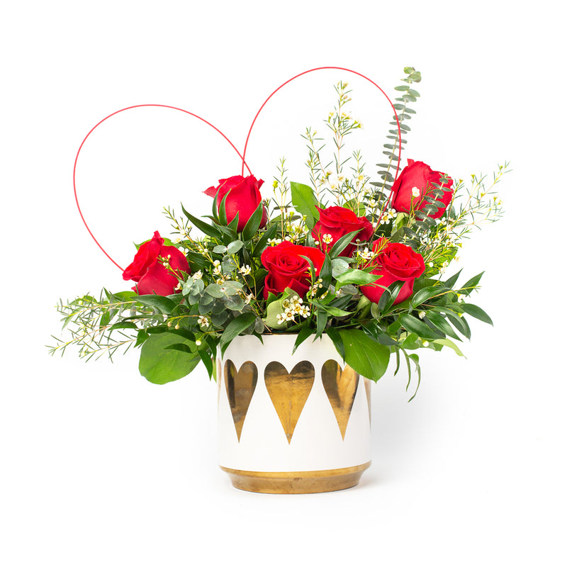 Valentine's Day arrangement of roses in a pot with gold hearts. Floral design by Tickled Floral in Sherwood Park, AB