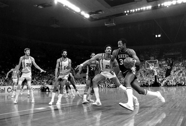 Blazers forward Maurice Lucas (20) defends 76ers forward George McGinnis (30) as teammates Bill Walton (32) and Lionel Hollins (14) look on during Game 4 of the 1977 NBA Finals. -- ROGER JENSEN / THE OREGONIAN/OREGONLIVE