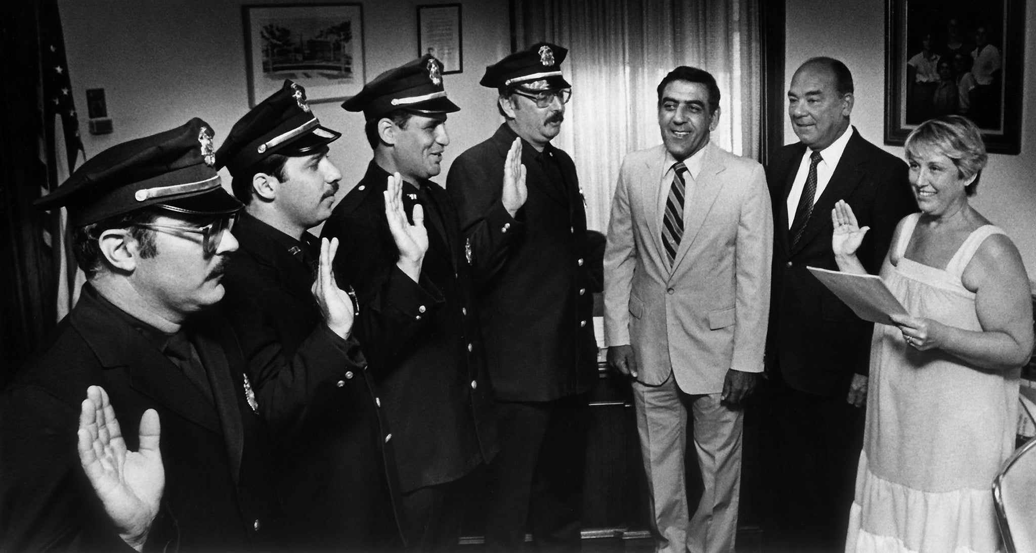 Mayor Peter Torigian standing with Chief Robert Costello and City Clerk Natalie Maga as she swears in Robert Lynskey, Richard Robillard, Joseph Beraroino and Brian White Jr., August 9, 1983. -- Courtesy The Salem News
