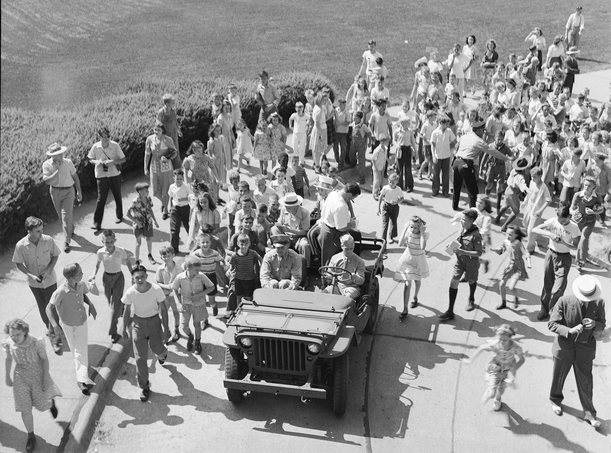 Bud Abbott and Lou Costello signing autographs for children from a jeep in front of the State Capitol Building, July 31, 1942. -- Courtesy Nebraska State Historical Society / #RG2183.PH001942-000731-2