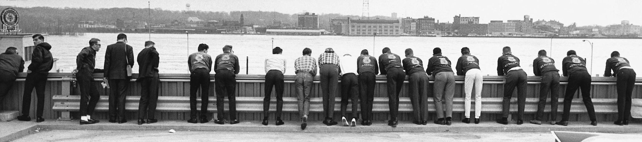 Group looking at the swollen Mississippi River from atop a parking ramp in downtown Davenport, 1965. -- Quad-City Times