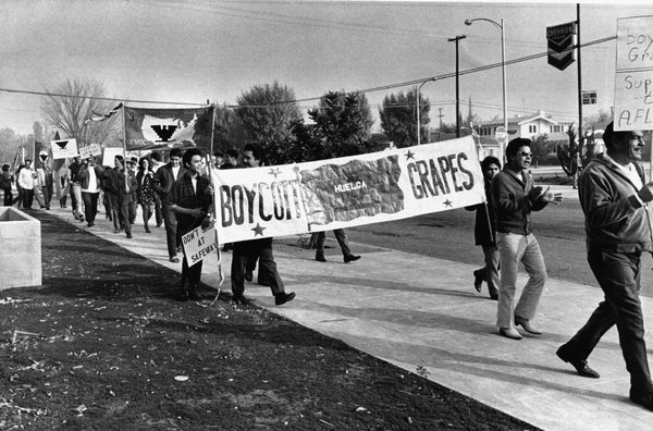 Jose Cortez, a United Farm Workers volunteer, leads a march of 120 people to the Safeway headquarters on Barstow Avenue to protest the selling of table grapes, November 25, 1969. Cortez would go on to serve as a bodyguard to Cesar Chavez. -- Courtesy The Fresno Bee
