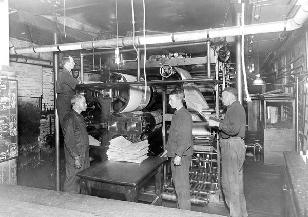 The Salem Evening News printing room, circa 1910s. -- Salem State University Special Collections