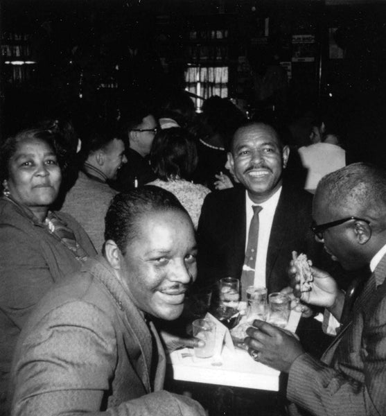 Touring musicians Sonny Terry and Brownie McGhee mingling with customers at Lennie's in February 1964. -- Salem State Archives