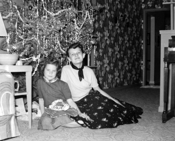 Myrna and Judy Dahl celebrating Christmas at the family home at 2703 Woods Drive, 1953. -- MYRNA DAHL MARTINSON