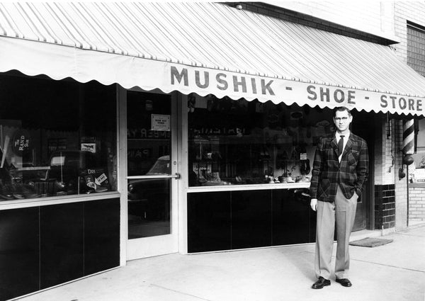 John Mushik III, in front of his family–owned shoe store, 116 W. Main, Mandan, 1957. John was the third generation of Mushiks who owned and operated the store for 70 years.  -- Courtesy Becky Mushik Roesler