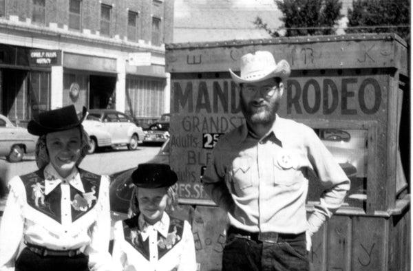 John, Gwen, and daughter Becky Mushik, all dressed up and ready to go to the Mandan Rodeo, 1950. Men were encouraged by the Chamber of Commerce to grow their beards for Rodeo Days. -- Courtesy Becky Mushik Roesler