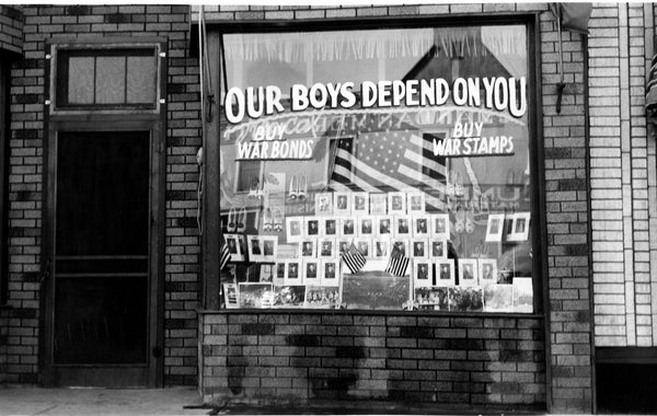 A patriotic display in the window at Mushik Shoe Store, 112 W. Main St., Mandan, 1942. Photos of Mandan and surrounding area men who were serving in the armed forces in World War II were displayed. The Mushiks had three sons in that window display. -- Courtesy Becky Mushik Roesler