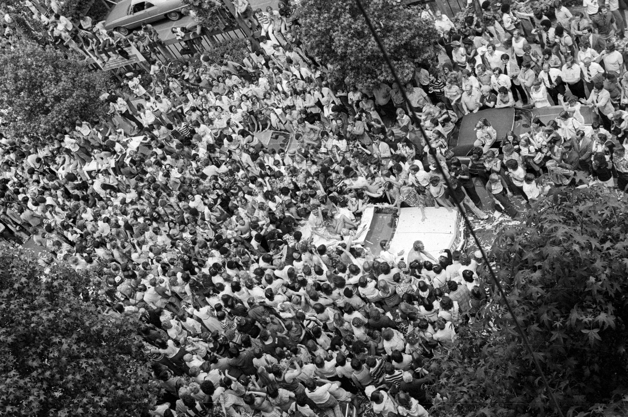 Blazers fans surround the convertible Bill Walton is riding in during the Blazers' 1977 victory parade. Walton initially tried to ride his bike, but the sea of fans made it impossible. -- ROGER JENSEN / THE OREGONIAN/OREGONLIVE