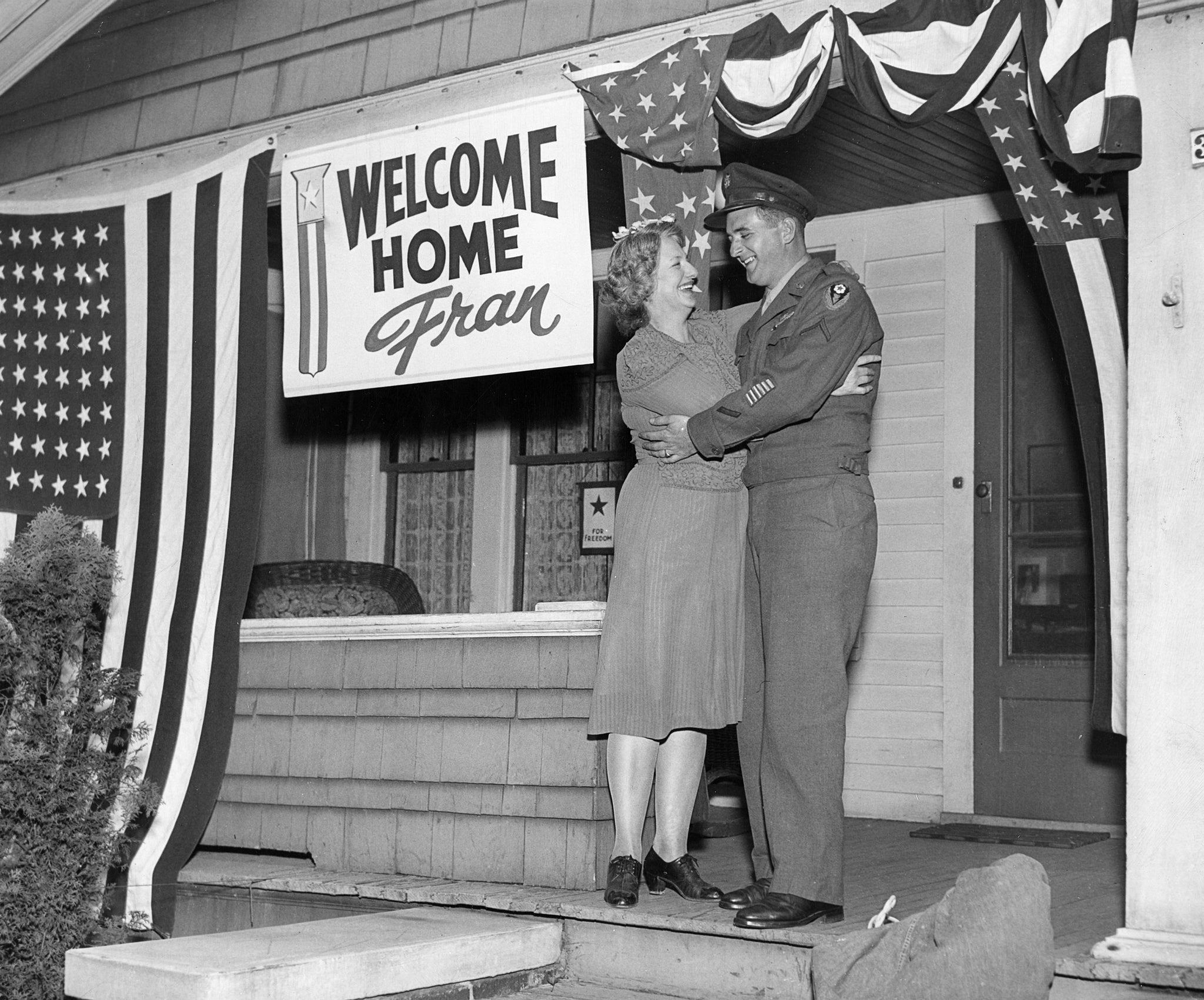 Fran Dickinson comes home from Europe after serving in the Battle of the Bulge, Oct. 12, 1945. He is greeted by his mom, Anna, at their home at 30 Berwyn Ave. -- BILL DICKINSON