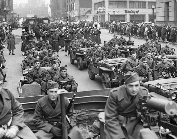 A squad of peeps from Pine Camp descend on Niagara Square from Court Street in the Army Day Parade, April 1942. The peep was smaller than its better-known brother, the jeep, and could cross almost every kind of terrain; mud, sand and shallow water. -- BUFFALO NEWS ARCHIVES