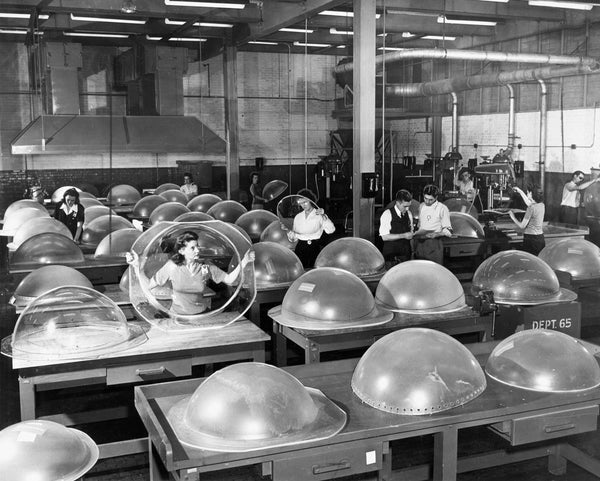 Bell Aircraft workers inspect machine gun turrets in 1944. -- BUFFALO NEWS ARCHIVES