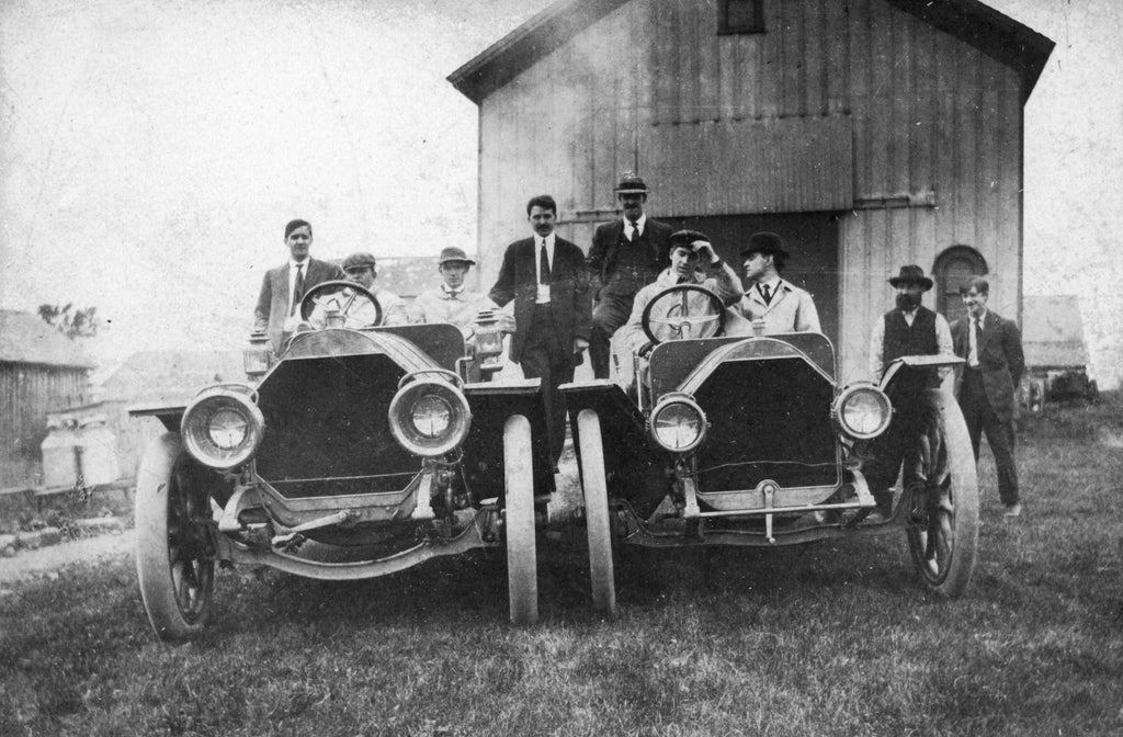 E. R. Thomas Company employees with Thomas Flyer cars, 1908. The test driver on the right is Clarence Buxton. Clarence was scheduled to drive in the 1908 New York to Paris race, but decided to stay home since his wife was expecting their first child.