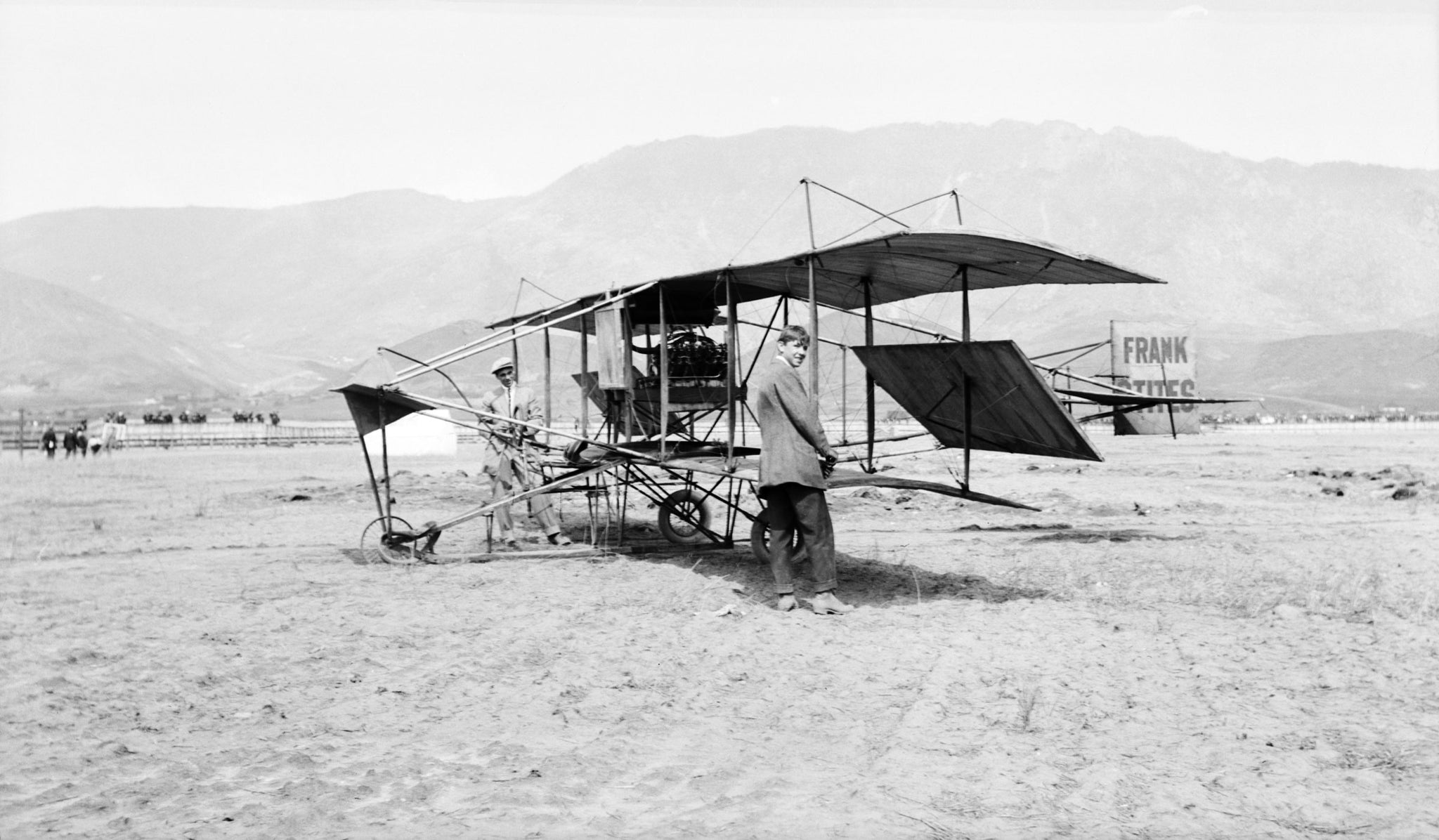 Eugene Ely with his biplane. He flew in Butte on June 9, 1911. When he landed, he plowed into the fairgrounds and damaged the tires on his airplane. -- Mike Byrnes Collection