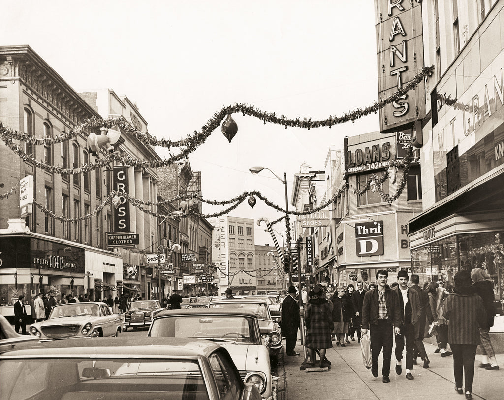 The cover image, courtesy of Hart Cluett Museum, depicts holiday decorations along Third Street and Broadway in Troy, circa 1966.