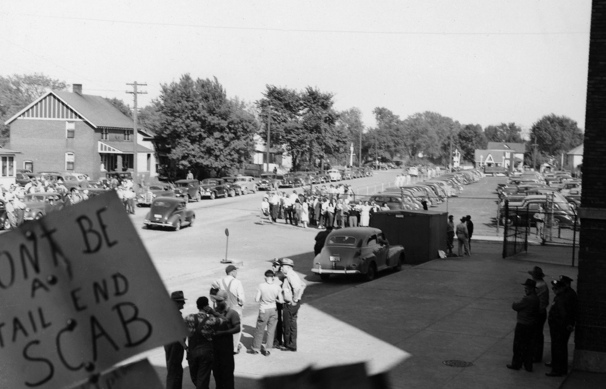 Picketers on Sycamore Street during a Rath Packing Company strike in 1948. -- Leo R. Larson