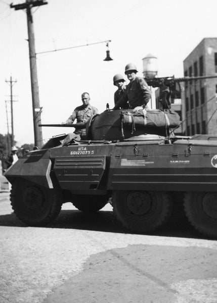 The national guard in their tank for the Rath Packing Company strike in 1948. -- Leo R. Larson