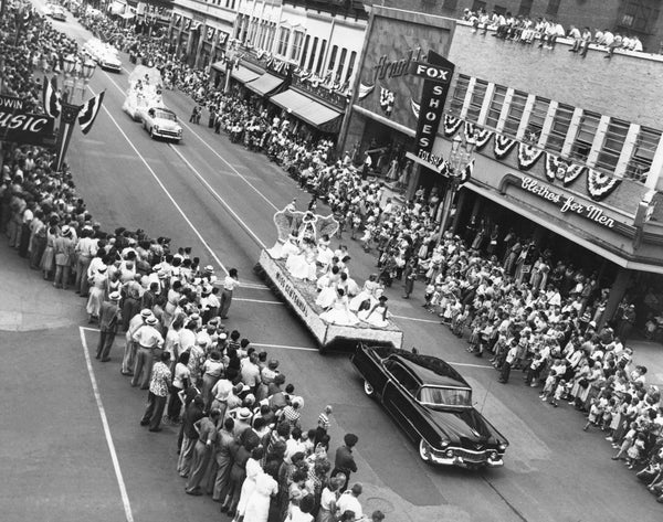 A car pulling the Miss Centennial float for the centennial celebration, 1954. -- Courtesy Grout Museum Archives