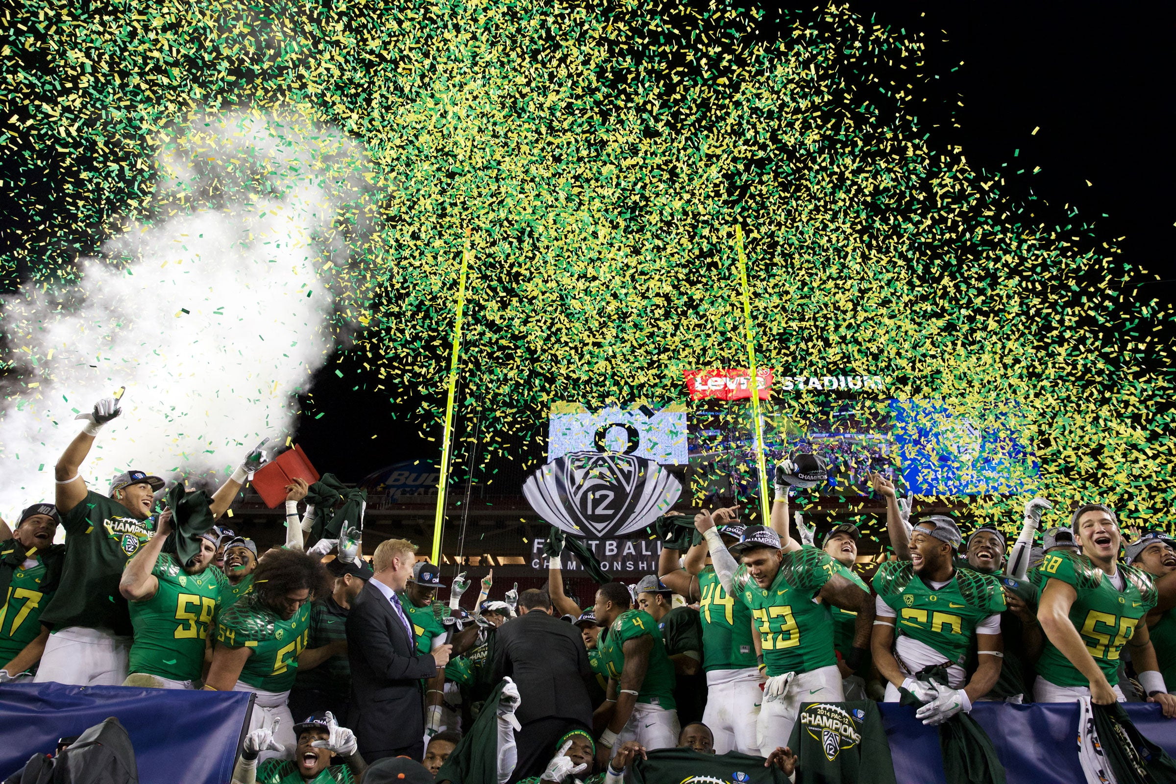 The Oregon Ducks celebrate their second Pac-12 Championship in as many appearances, their first being a win over UCLA in 2011. Photo by Thomas Boyd The Oregonian/OregonLive.