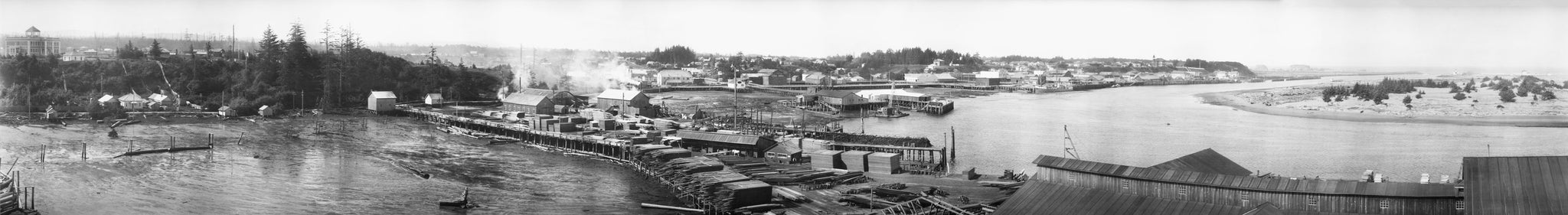 F. W. Sheelor, a pioneer of panoramic photography, took this photograph of Bandon's harbor and mills from the water tower of Moore Mill. -- Courtesy Bandon Historical Society Museum
