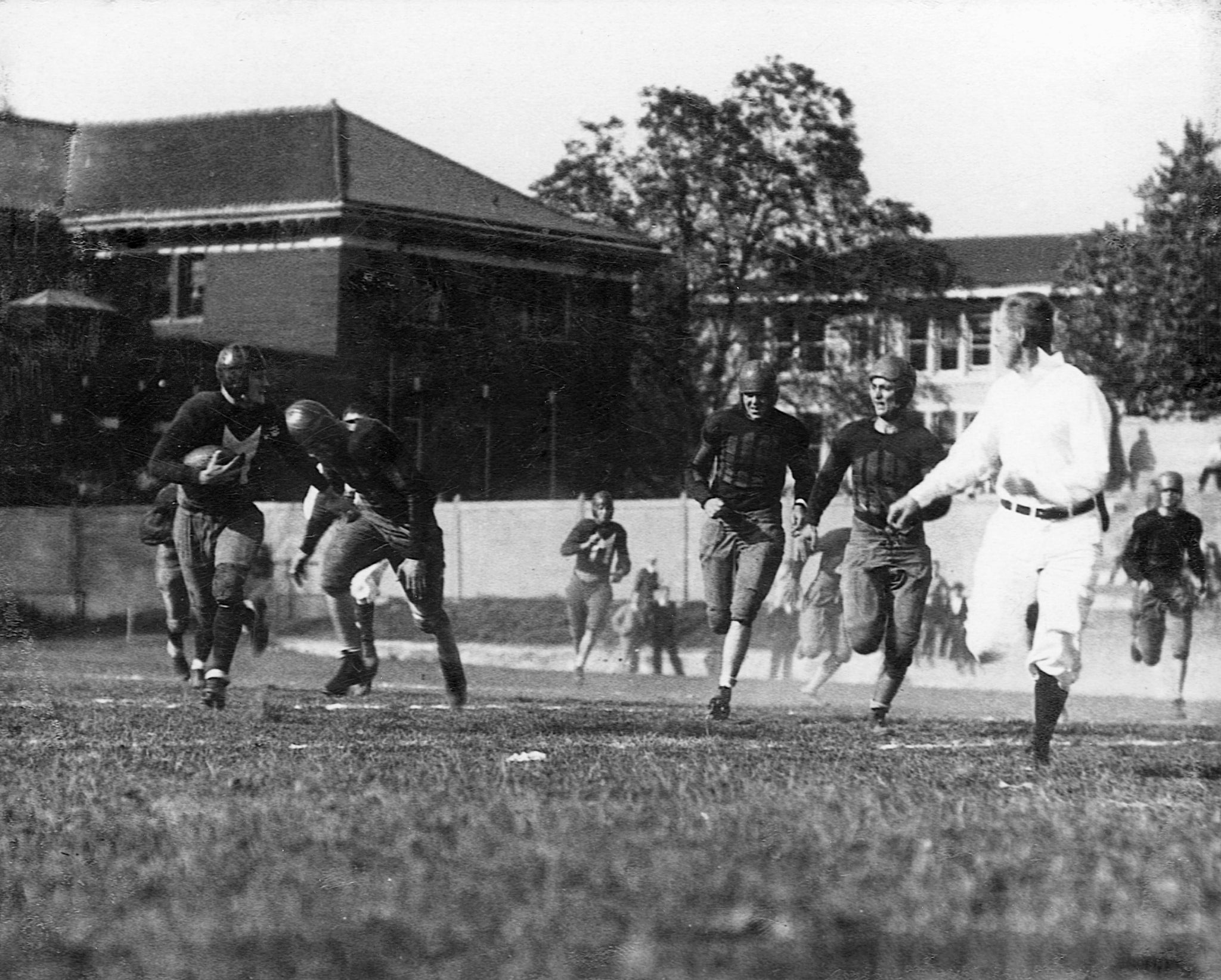 "Meadville High School running back Ford ""Duffy"" Weber, left, breaking away in a 48-0 victory over Warren at Montgomery Field, Allegheny College, 1929. -- Courtesy of Mark Duff Weber"
