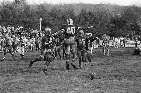 Allegheny College players celebrating a touchdown on November 24, 1990. -- Courtesy of the Meadville Tribune