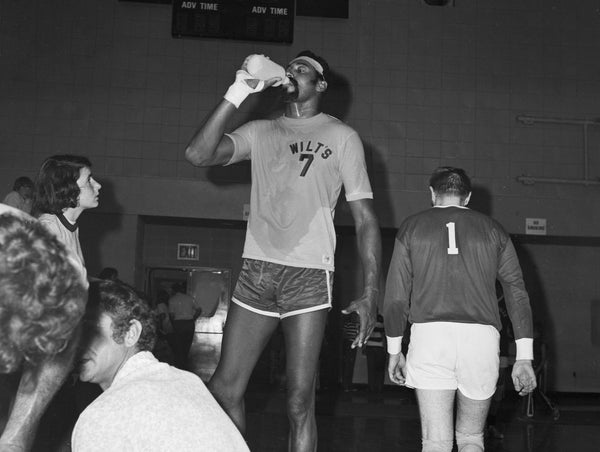 "NBA legend ""Big Dipper"" Wilt Chamberlain standing head, shoulders, and torso over the competition at a volleyball match versus the Meadville YMCA team at David Mead Field House, May 27, 1972. -- COURTESY MEADVILLE TRIBUNE"